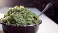 A panning shot of a bowl of fresh guacamole video