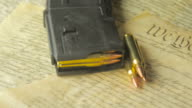 Panning Shot of Ammunition Lying on the Constitution of the USA video