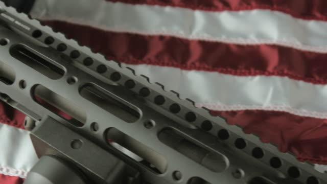 Panning Shot of an Assault Rifle Lying on an American Flag video