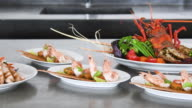 Panning shot of local seafood dishes on kitchen counter, Sri Lanka video