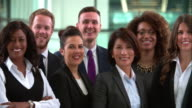 Panning shot of smiling business colleagues video