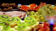 Panning shot of the table full of food video