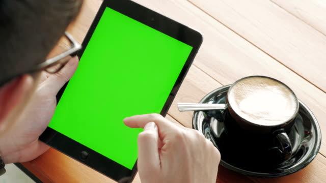 Panning shot of Using digital tablet,Green screen video
