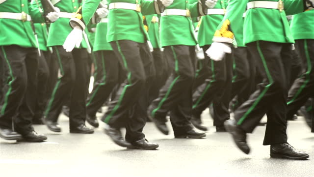 HD Panning: Soldiers marching in the streets. video