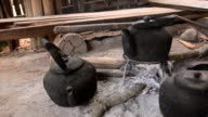 panning: three Steaming tea kettle  by traditional method video