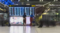 4K Panning Timelapse : Flight Schedules in airport terminal time lapse video