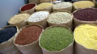 Panning to beans in street market. video