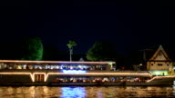 panning: traveling Wat Arun at night by ship video