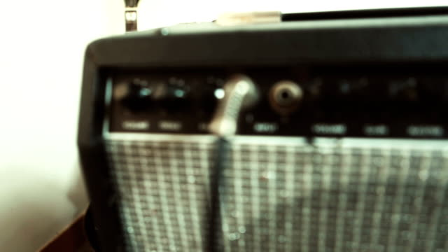 Panning video on amplifier and electric guitar video