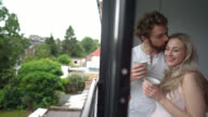 Panning view of loving couple talking and kissing video