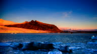 Panning view of sunrise on the snowy mountain by the glacier video
