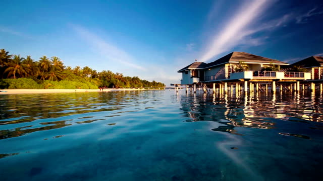 Panning view of the over water villas and tropical island video