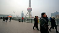 Panning view of visitors wander near the famous Oriental Pearl TV Tower, Shanghai, China video