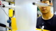 panning: young engineer consider blown film operations video