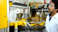 panning: young engineer thinking and looking blown film extruder video