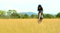 panning: young woman feeling happy on Savannah field video