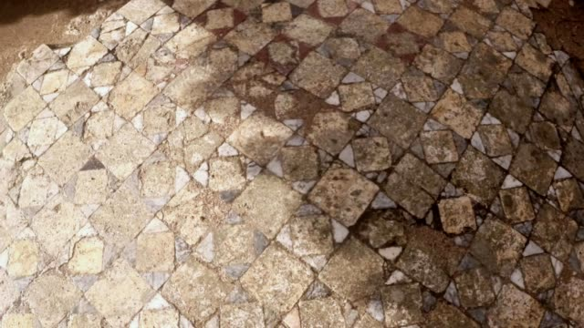 Panorama close up layings of marble tiles on floor  ruins of antique town Salamis east Cyprus video
