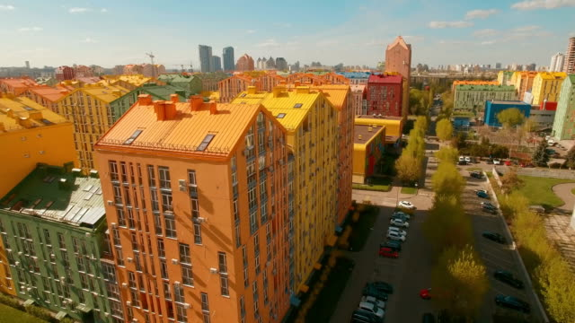 Panorama cozy comfortable colorful buildings in a European city 4K UHD aerial video