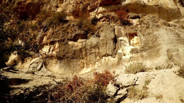 Panorama from left to right The Man Rocks figures in niches Adamkayalar overall plan Mersin province Turkey video