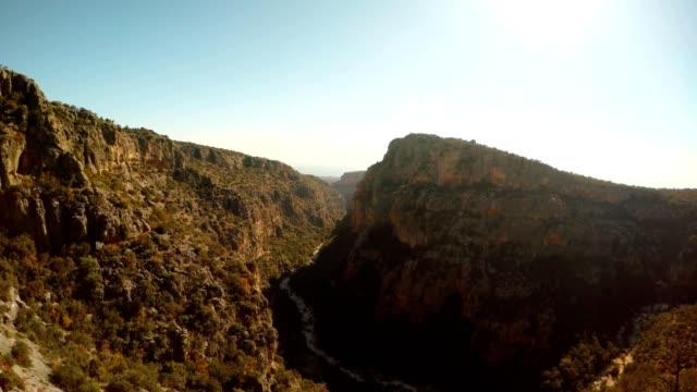 Panorama Gorge Seytanderesi and figures in rocks antique city Adamkayalar far sea sunny day Mersin province Turkey video