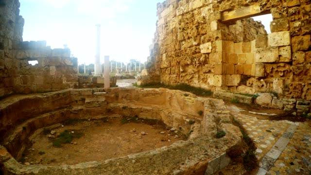 Panorama in room with octagonal pool far columns and tourists antique town Salamis east Cyprus Famagusta video