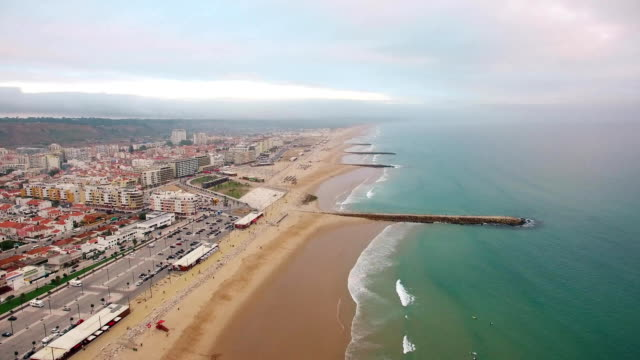 Panorama of Costa Caparica beach at evening aerial view video