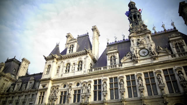 Panorama of Hotel de Ville in Paris, antique architecture and flags on building video