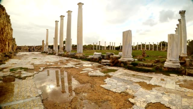 Panorama Reflections in puddle of water of columns of Roman Agora and sky with clouds antique town Salamis video
