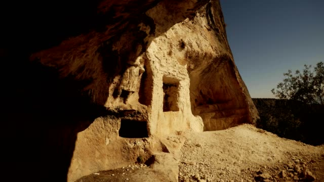 Panorama Rock carved caves and figures in niches Adamkayalar Turkey famous landmark Mersin province video