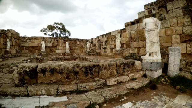Panorama Room with pool and antique white headless statues ruins ancient town Salamis east Cyprus Famagusta video