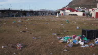 Panoramic shot of litter in a park video