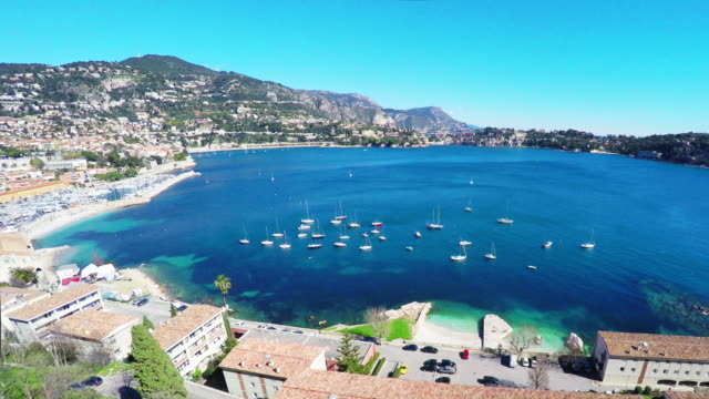 Panoramic view of coastline and beach with blue sky, luxury resort and bay with yachts, Nice port, Villefranche-sur-Mer, Nice, Cote d'Azur, French Riviera. video