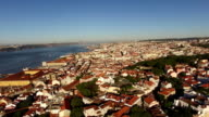 Panoramic view of old Lisbon and Tagus river at morning aerial view video