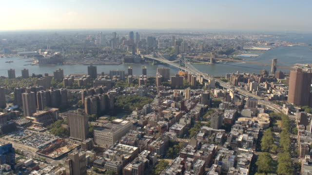 AERIAL: Panoramic view of stunning Brooklyn and Manhattan cityscape on sunny day video