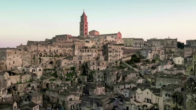 panoramic view of typical stones and church of Matera under sunset sky video