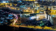 Panoramic view on Jerusalem night timelapse with traffic on the road from the Mount of Olives video