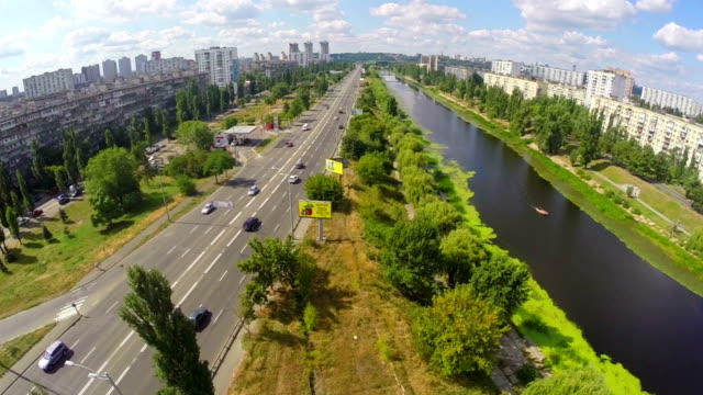 Panoramic view, river and busy street with cars, aerial shot video