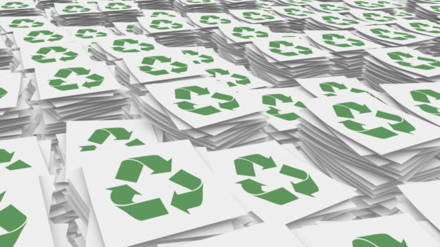 Paper Stacks Pile Up with Recycling Symbol video