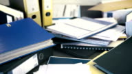 Paper work piles up and gets worked off video