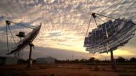 Parabolic solar dishes on a Solar Farm at Sunset video