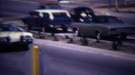 1972: Parade of little league baseball players driving to tournament. video