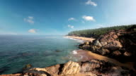Paradise beach with stones and palm trees, aerial view. Kerala, India. video