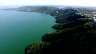 Paradise over Lake Travis flying forward over large Hillside and Turquoise blue summer time waters below video