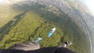 POV paraglider descending in mid air video