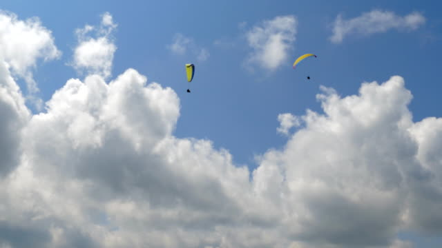 Paraglider flying high in the mountains video