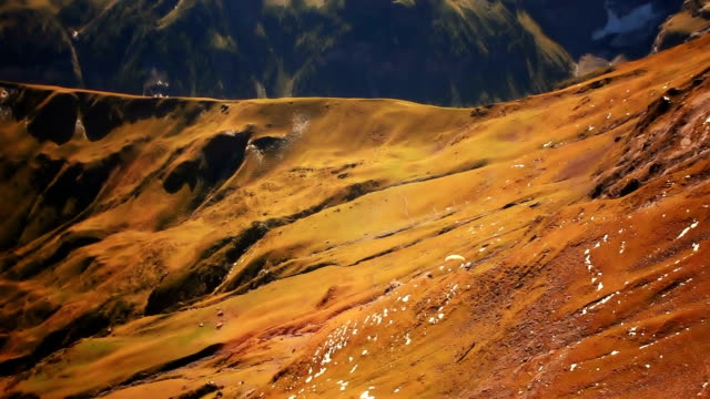 Paraglider flying over Jungfrau and Schilthorn video