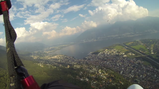 POV paraglider flying over the Alps video