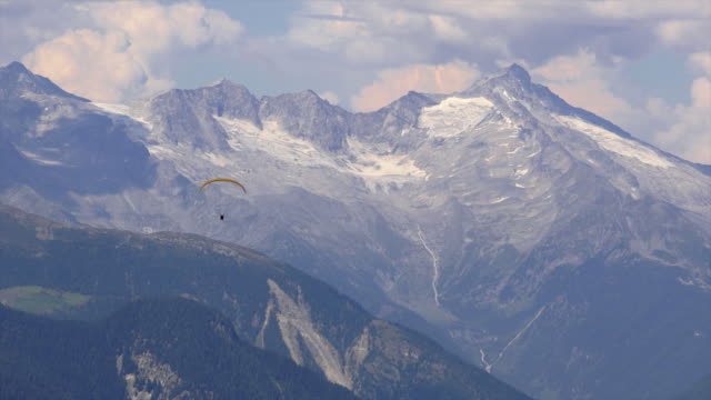 Paraglider In Front Of High Mountain Range video