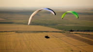 Paraglider in the sky over the steppe video