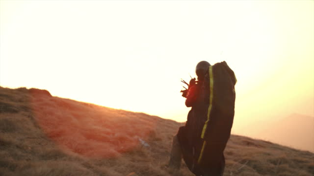 HD: Paraglider Launching Off The Hill video